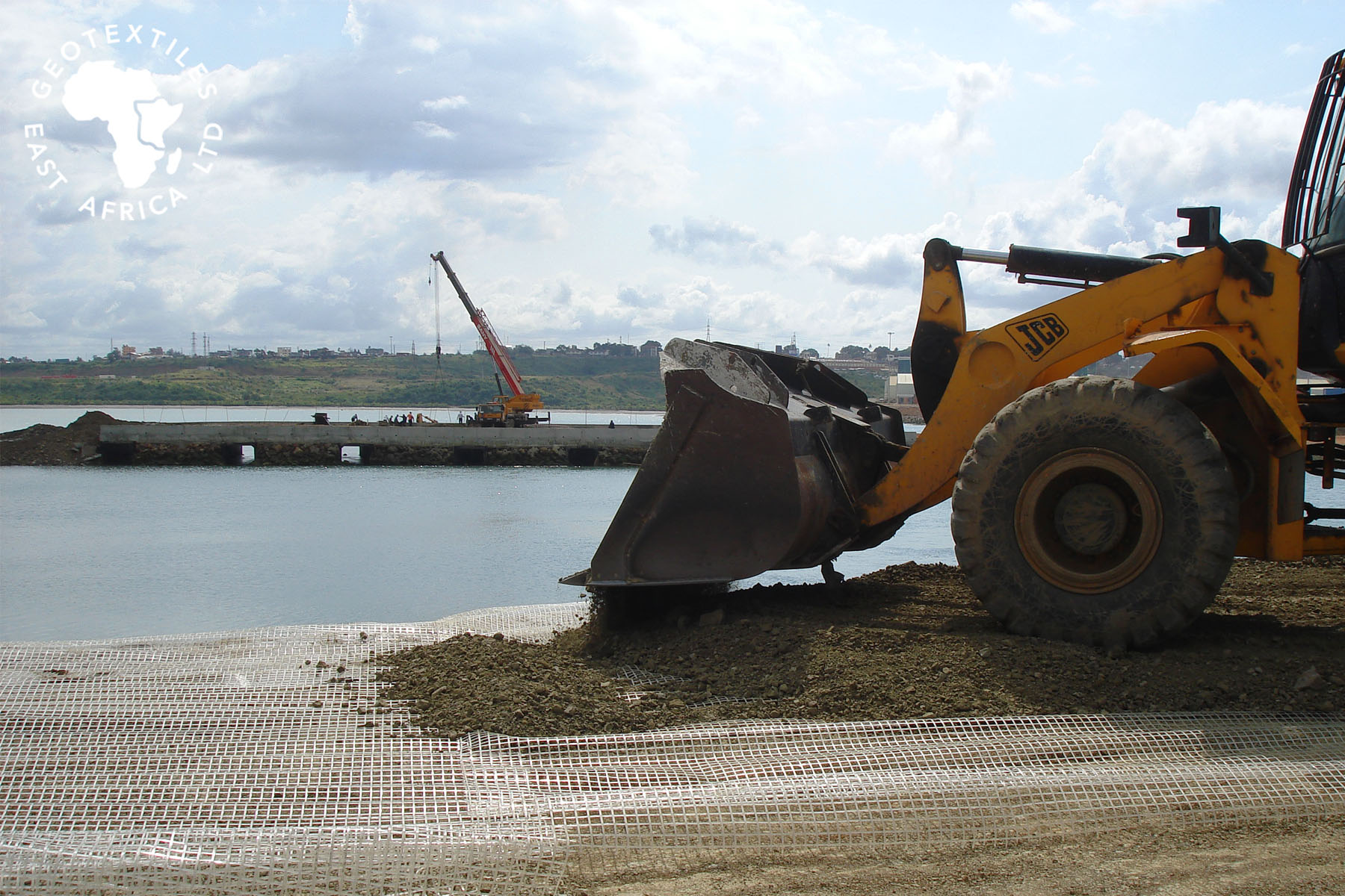 geogrids and geotextiles in wrap layers for bridge construction