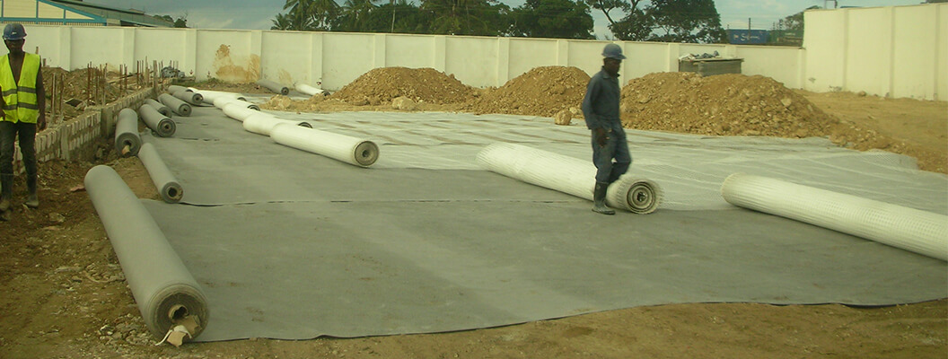 geogrid installation for base course reinforcement for transport yard