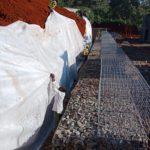 geotextile installation behind gabion retaining wall